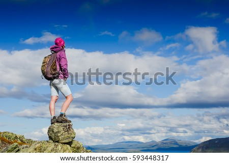 Active female hiker in rocky mountains #593448317