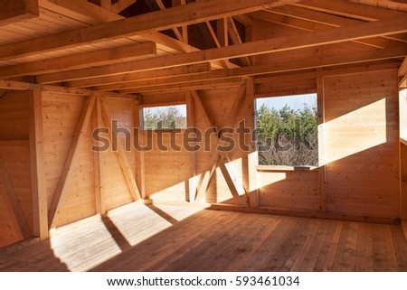 Wooden beams on the construction of ecological buildings. Construction site timber construction #593461034