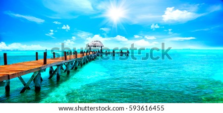 Exotic Paradise. Travel, Tourism and Vacations Concept. Tropical Resort. Caribbean sea Jetty near Cancun, Mexico Royalty-Free Stock Photo #593616455