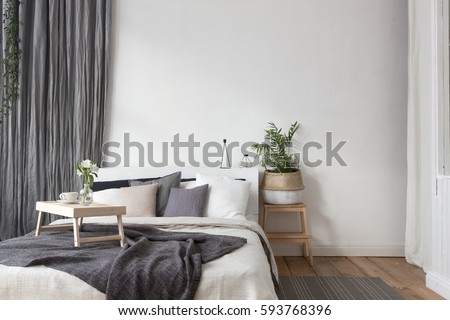Interior of white and gray cozy bedroom #593768396