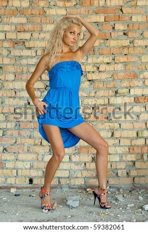 Beautiful sexual girl model pose beside old brick wall #59382061