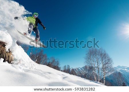 snowboarder is jumping with snowboard from snowhill #593831282
