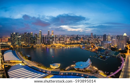 Aerial view of Singapore business district and city at night in Singapore, Asia. #593895014