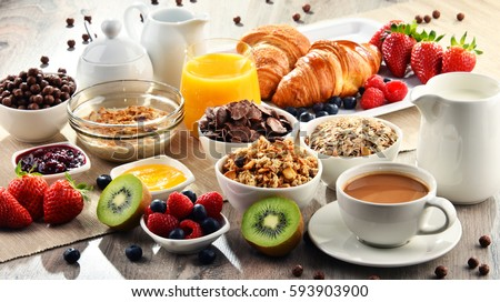 Breakfast served with coffee, orange juice, croissants, cereals and fruits. Balanced diet. #593903900