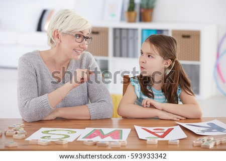 Problematic child studying alphabet with private teacher #593933342
