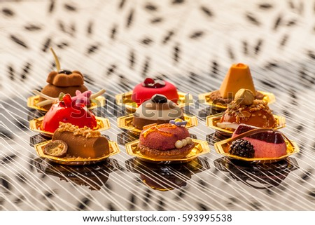 Mini cakes with chocolate and fruits #593995538