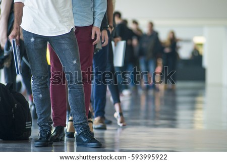 Shoes of people doing a line in a casting for a catwalk - Barcelona Royalty-Free Stock Photo #593995922