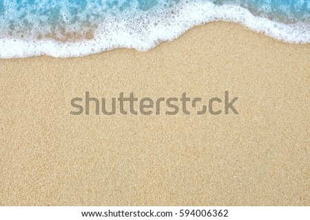 The sand beach with soft wave. #594006362
