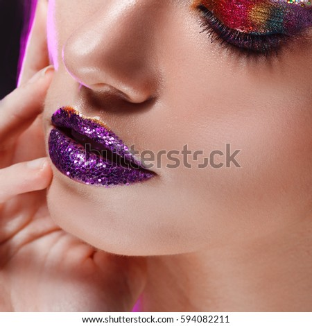 Young beautiful girl with creative make up. Attractive blonde, closeup #594082211