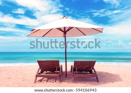 Beautiful beach. Chairs on the  sandy beach near the sea. Summer holiday and vacation concept. Tropical beach. #594106943