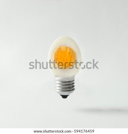 Egg lightbulb on bright background. Idea concept.