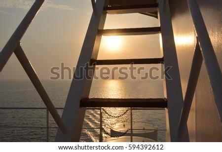 Ship ladder and ocean sunset #594392612