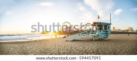 Santa Monica pier at sunset, Los Angeles Royalty-Free Stock Photo #594457091