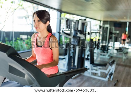 Woman training in gym room #594538835