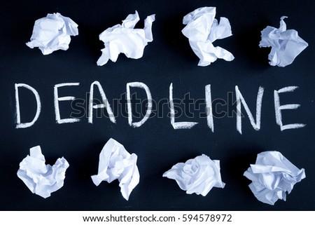 deadline concept on dark background top view #594578972