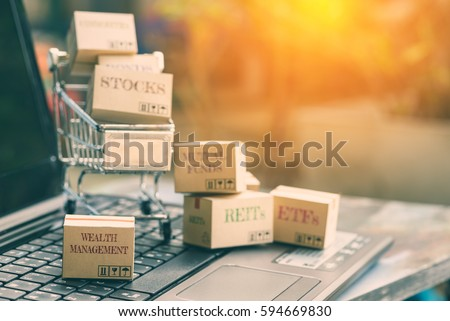 Boxes of many types of financial investment products with the one labelled wealth management falls outside a shopping cart. Wealth management is important for everybody who rely on passive income. #594669830