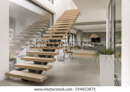 Minimalistic stairs in modern villa interior Royalty-Free Stock Photo #594853871