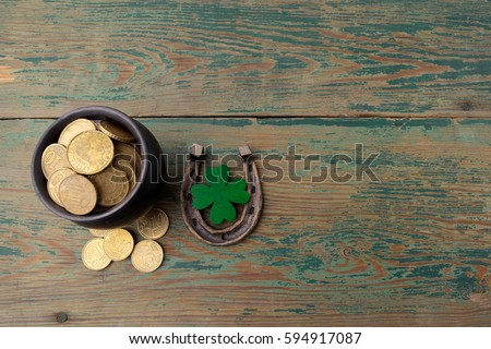 St. Patricks day, lucky charms. Horesechoe and shamrock on wooden background #594917087