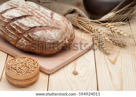 loaf of rye bread on wooden table #594924011