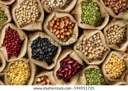 Legumes bean seed in sack, top view Royalty-Free Stock Photo #594951725