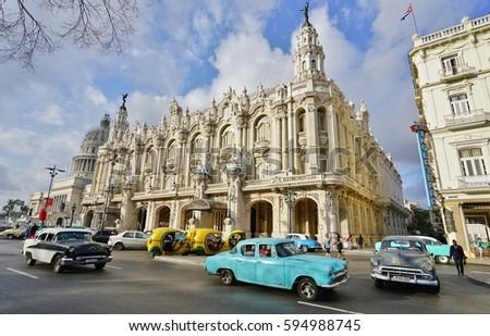 HAVANA, CUBA -3 FEB 2017- Vintage classic American cars in front of the landmark Gran Teatro de La Habana Alicia Alonso in Havana, the capital of Cuba. #594988745