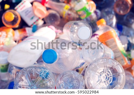 plastic bottle in recycle bin,waste management concept. Royalty-Free Stock Photo #595022984