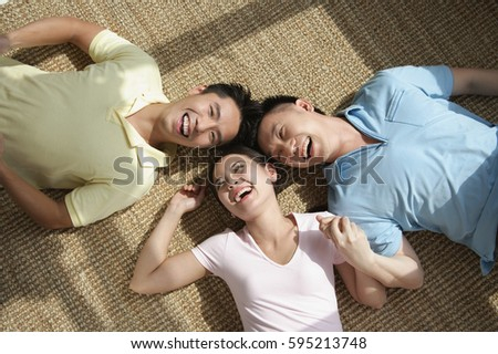 Friends lying on the floor laughing #595213748