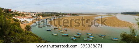 Lagoon Moulay Bousselham fishing boats, Morocco #595338671