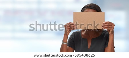 Business woman hiding face with cardboard. #595438625