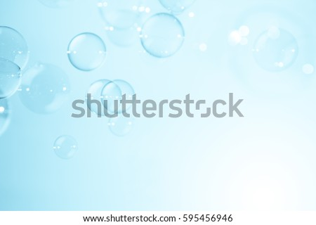 soap bubbles on blue natural background
