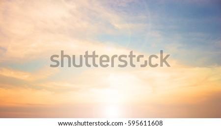 cross on blurry sunset background,  #595611608