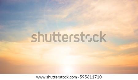 cross on blurry sunset background,  #595611710