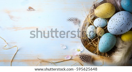 Easter background with Easter eggs and spring flowers. Top view with copy space.  Royalty-Free Stock Photo #595625648