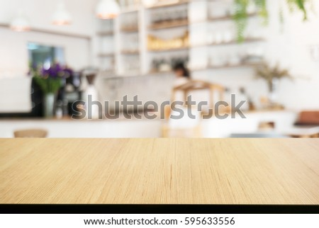 Empty wooden table in front of abstract blurred background of cafe. can be used for display or montage your products.Mock up for display of product #595633556
