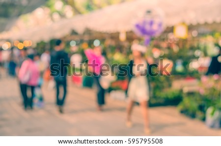 vintage tone blur image of day market on street with bokeh for background usage . #595795508
