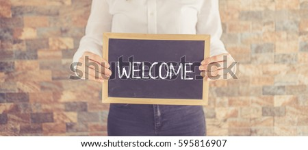 WELCOME CONCEPT Royalty-Free Stock Photo #595816907