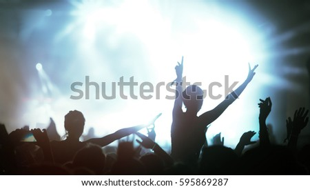 Crowd enjoying concert at festival dancing and partying #595869287