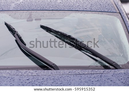 view of the car windshield wipers in the rain Royalty-Free Stock Photo #595915352