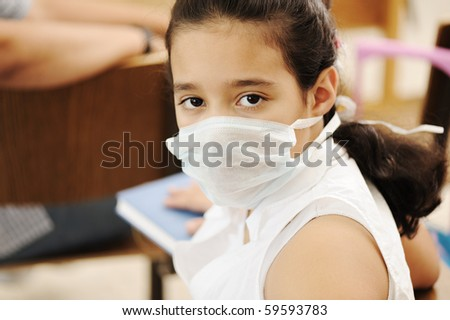 Schoolgirl with medicine mask on face, in classroom, against: virus, ill, epidemic, plague, flu #59593783