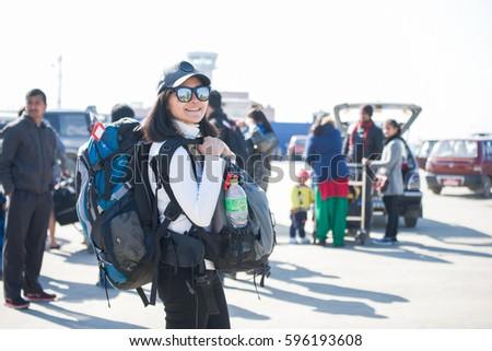 Nepal - 3 January 2017 ::woman backpacker carry her backpack at Kathmandu airport , Nepal #596193608