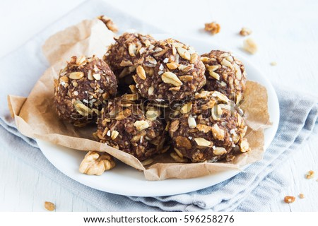 Healthy organic energy granola bites with nuts, cacao, banana and honey - vegan vegetarian raw snack or meal Royalty-Free Stock Photo #596258276