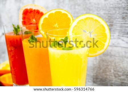 freshly squeezed orange juice, lemon and grapefruit #596314766