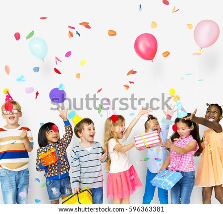 Group of kids celebrate birthday party together Royalty-Free Stock Photo #596363381