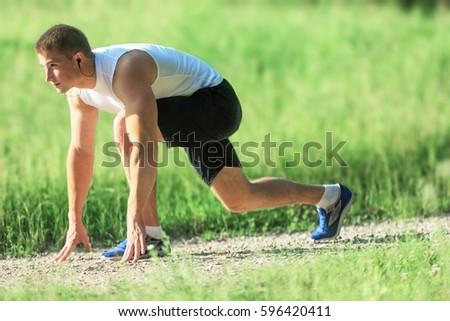 Man running in the park. #596420411