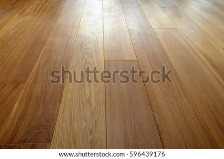 Perspective of Hardwood floor in close up Royalty-Free Stock Photo #596439176