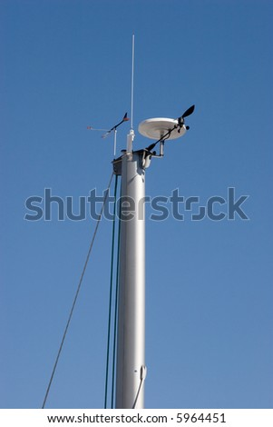 The top of a sailing ships mast against a blue sky #5964451