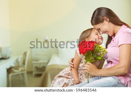 Woman and child with bouquet of flowers. #596483546