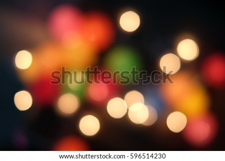 Photo of bokeh lights on black background. City night lights. Effect golden light texture and design.