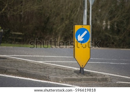 Traffic guide arrow at roundabout - blue yellow and white Irish Road Signs