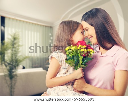 Woman and child with bouquet of flowers. #596655593